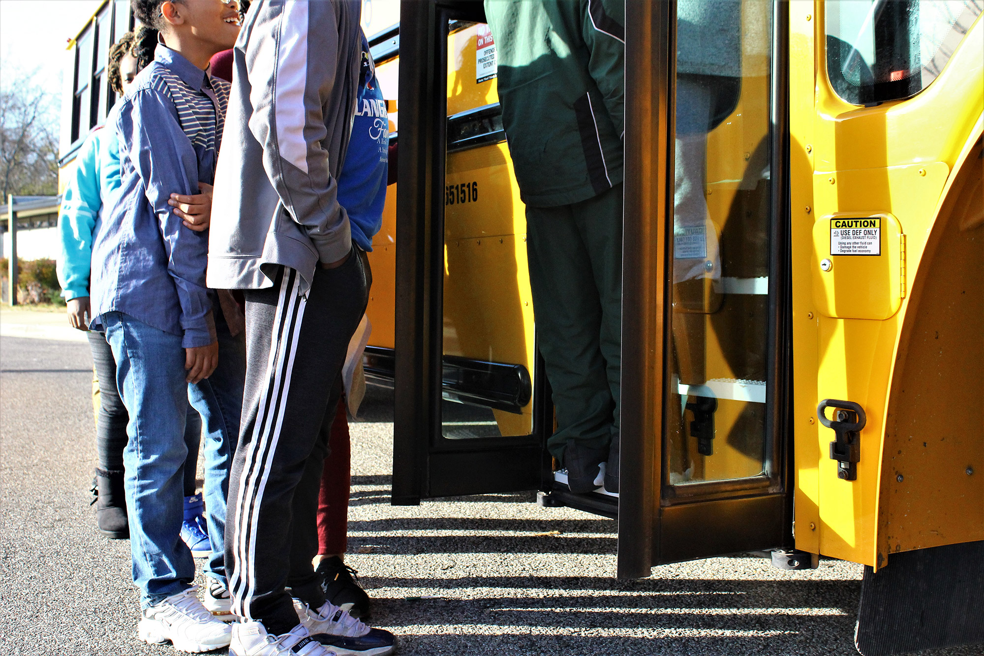 kids getting on to a bus